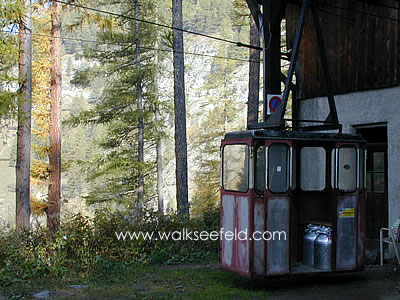 A cable car being used to transport milk churns in the South Tyrol